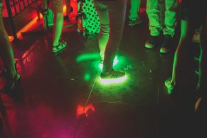 Sneakers with lights in them at a disco