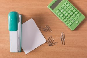 office supplies on a wooden desk