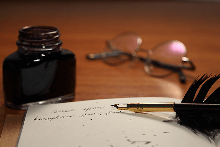 An Antique Quill Pen and Paper