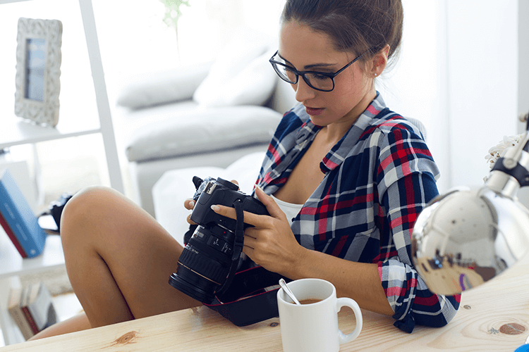 A staged scene of a photographer and her camera