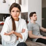 woman on couch annoyed by boyfriend