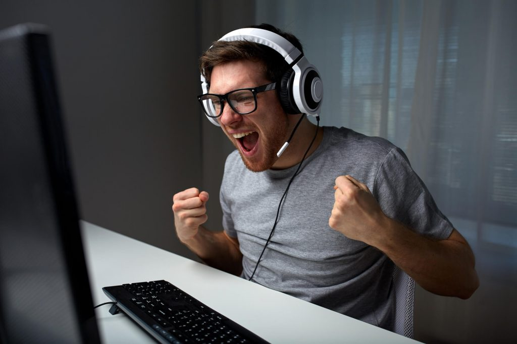young man playing computer game