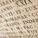 Ancient Latin inscription carved into stone