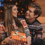 Young Couple Exchanging Gifts at Christmas